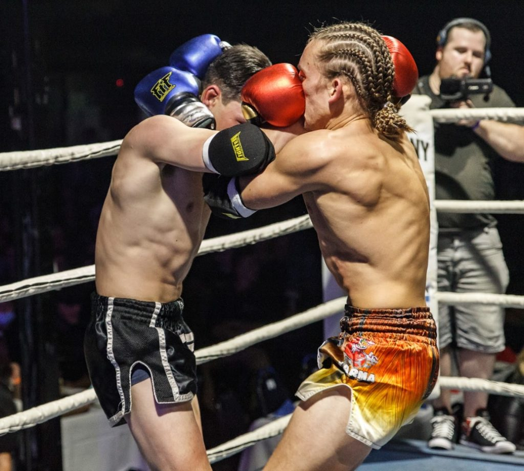 two fighters in a Muay Thai clinch
